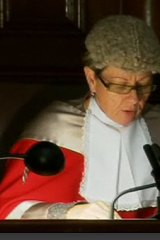 Justice Megan Latham reads her sentence in court today.