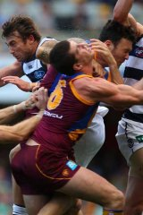 The Brisbane Lions' Jonathan Brown collides with teammate Mitch Clark (right) in a pack in the game against Geelong at the Gabba.