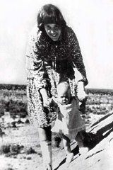 Painful history ... Lindy Chamberlain with Azaria at Uluru.