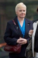 Former senior Austrade commissioner Elizabeth Masamune leaves Melbourne's County Court yesterday.