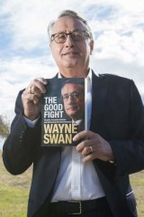 Wayne Swan poses near his offices in Nundah with a copy of his book, <i>The Good Fight</i>.