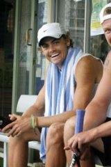 Sam Groth and fellow tennis professional Brendan Moore (left).