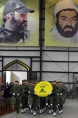 Hezbollah fighters parade on Hezbollah martyr day in Beirut, Lebanon. The Iranian Intelligence Minister, Heydar Moslehi said 12 alleged US spies were captured.