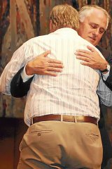 Malcolm Turnbull hugs Peter Hicks during his apology speech to the forgotten generation.