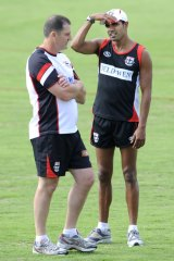 St Kilda coach Ross Lyon talks to Andrew Lovett yesterday.