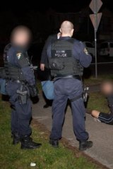 Extraordinary powers: Police hold three suspects without charge.
