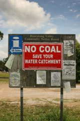 Protest: A sign on the Wyong River, near the site.