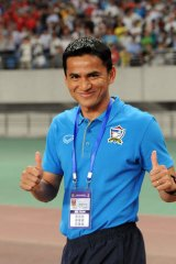 Thailand's coach Kiatisuk Senamuan celebrates after the win in Hefei.
