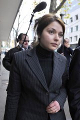 Nazira Rafei leaves court.