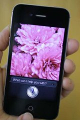 Siri, the virtual assistant, is displayed on the new Apple iPhone 4S.