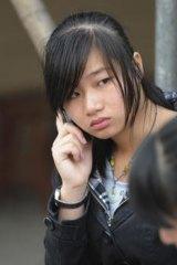 Xue Jianwan, the daughter of Xue Jinbo, who died in police custody.