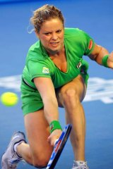 The Belgian in action against China's Li Na in the final at Melbourne Park.