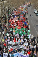 Tens of thousands of trade unionists, environmental campaigners and anti-globalisation activists protest in London.