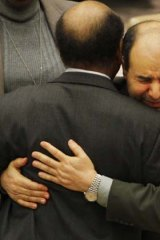 Libya's deputy UN ambassador Ibrahim Dabbashi (right) embraces Libya's UN ambassador Mohamed Shalgham after a meeting of the Security Council at United Nations headquarters in New York.
