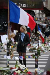 Memorials at Le Carillon bar and Le Petite Cambodge restaurant in Paris on Thursday.