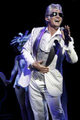 Todd McKenney as Teen Angel in <i>Grease</i>.