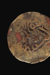 Coin of destiny … one of the copper alloy coins from East Africa's Kilwa Kisiwani sultanate that were found on Marchinbar Island.