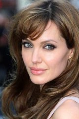 Angelina Jolie - beautiful...but burdened?