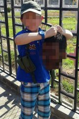 A boy believed to be Australian Khaled Sharrouf's son holds the decapitated head of a soldier.