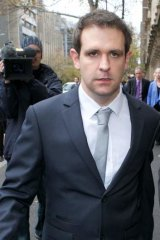 Grieving husband Tom Meagher leaves court after facing his wife's killer.