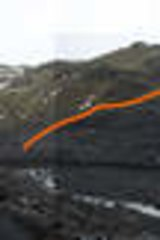 The Solheim Glacier in Iceland in February 2009, with its height in 2006 indicated by the orange line.