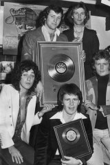 Australian  pop group Sherbet, with their gold single for their record <i>Howzat</i> in 1976. From left to right, Alan Sandow, Harvey James, Tony Mitchell, Garth Porter and Daryl Braithwaite.