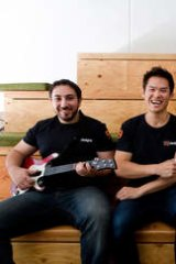From far left, Michael Mifsud, Richo Healey, Jason Hoy and Luke Cawood play guitar hero at 99 Design in Collingwood.