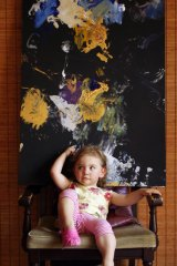 Portrait of the young artist: Aelita Andre, 2, with one of her paintings.