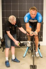 Fighting fit: Gary Suckling, owner of Riders Choice in Leederville kitting out Neil Brooks with a new bike for the coming triathlon series in WA.