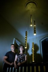 Lighting designer Ilan El with client Alex Caldwell and the Rain light he created for her.