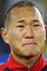 Crying his eyes out ... North Korea's star player broke down during the national anthem.