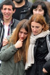 Struggling to cope ... young people walk away from the Ozar Hatorah school in Toulouse.