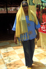 Lubna Hussein outside the Khartoum cafe where she was arrested for her way of dressing.