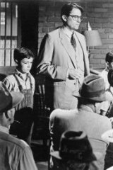 Gregory Peck stars as Atticus Finch and and Mary Badham as his daughter, Scout,  in the 1962  film <i>To Kill A Mockingbird</i>.