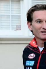 James Hird denies new allegations as he leaves his home.