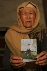 Disappeared: Tursungul Turdi has had no news of her son Eysajan Memet since he went missing during the Urumqi riots of July 5, 2009.