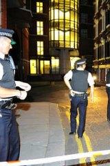 Police outside the Ecuadorian Embassy in London where Julian Assange is seeking political asylum. Photo: Paul Stewart