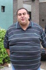 Guilty: Buhagiar outside court, spitting at a Fairfax Media photographer.
