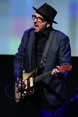 Elvis Costello performs at the Apple event.