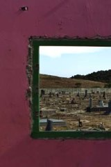 High-risk group ... a graveyard in Cape Town, which holds many people who have died from AIDS; an estimated 5.6 million people are infected in South Africa.