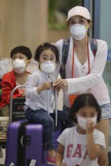 Passengers wear masks as a precaution against MERS.