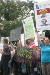 Disgruntled Queensland teachers rally at Parliament House in Brisbane today.