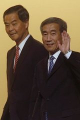 "Against ""confusion"": Li Fei (right), deputy general secretary of the National People's Congress standing committee, with Hong Kong Chief Executive Leung Chun-ying."
