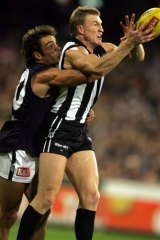 Case of the Blues: Nathan Buckley marks against Carlton in 2005.
