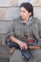 A PKK fighter rests after a night on the frontline.