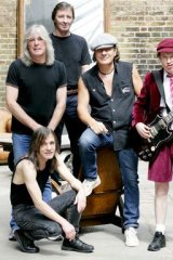 AC/DC's Brian Johnson, centre, says the band plans to record in Vancouver in May. Guitarist Malcolm Young, bottom left, is reportedly suffering from an illness.