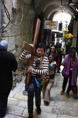 Way of the Cross … pilgrims from the Philippines on the Via Dolorosa, where Christ is said to have carried His cross to Golgotha 2000 years ago.