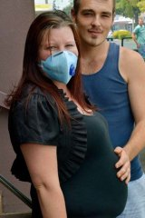 Pregnant mother Haylee Riess with her partner Josh Pollard.