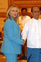 Reserving judgment ... Hillary Clinton is greeted by the Burmese President, Thein Sein, in the capital Naypyidaw yesterday.