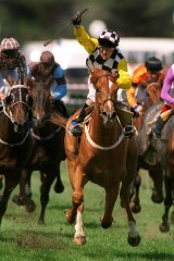 Darren Beadman celebrates as Saintly takes out the 1996 Melbourne Cup.